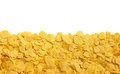 Yellow crispy cornflakes isolated on white background Royalty Free Stock Photo