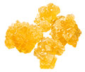 Yellow crystalline caramelized sugar isolated on white background Royalty Free Stock Photos