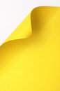 Yellow curl paper sheet with corner blank space background Royalty Free Stock Photo