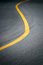 Yellow curve line on road dark for background Stock Photography