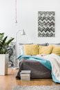 Yellow cushions and gray bedspread Royalty Free Stock Photo