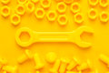 Yellow 3d printed bolts and nuts Royalty Free Stock Photo