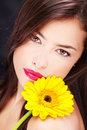 Yellow daisy on woman\'s shoulder Royalty Free Stock Photo