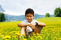 Yellow dandelions fields happy smiling years old black boy in the field Stock Photos