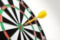 Yellow dart hitting target center Royalty Free Stock Photo
