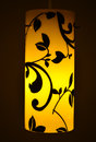 Yellow designer cylindrical lamp close up of with floral design Stock Image