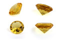 Yellow diamond crystals from different angles on a white background Royalty Free Stock Photos