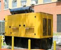 Yellow diesel powered generator heavy duty Stock Photo