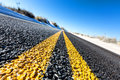 Yellow dividing line on asphalt road Royalty Free Stock Photography