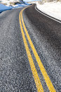 Yellow dividing line on asphalt road Royalty Free Stock Photo