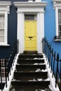 Yellow doorway residential house with entrance door Royalty Free Stock Photography