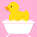 Yellow duck in bathtub with bubbles cute little floating an old retro style soapy over a pink tiled bathroom background cartoon Stock Photo