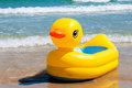 Yellow duck boat at the beach Stock Image