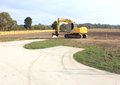 Yellow earth moving machine heavy duty on site in a new real estate subdivision in australia excavating the land ready for housing Royalty Free Stock Photo