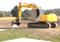 Yellow earth moving machine heavy duty on site in a new real estate subdivision in australia excavating the land ready for housing Stock Photography