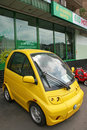 Yellow eco car moscow russia june small electric is parked near the pawnshop on the sidewalk side view Stock Photos