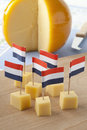 Yellow Edam cheese blocks with Dutch flags Royalty Free Stock Photo