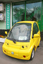 Yellow electric car moscow russia june small is parked near the pawnshop on the sidewalk Stock Photo