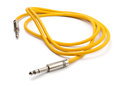Yellow electric guitar cable Stock Photo