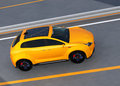 Yellow electric SUV on highway Royalty Free Stock Photo