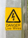 Yellow electrical lamp post warning sign