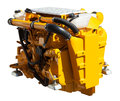 Yellow engine of motor boat isolated over white Stock Image