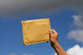 Yellow envelope against blue sky Stock Photography