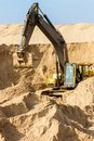 Yellow excavator at construction site working Royalty Free Stock Images