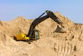 Yellow excavator at construction site working Stock Photography