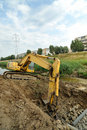 Yellow Excavator excavating on riverbed Royalty Free Stock Photo