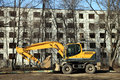 The yellow excavator on housebreaking Royalty Free Stock Photo