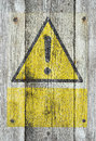 Yellow exclamation mark on wood Royalty Free Stock Image