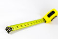 Yellow extended tape measure Royalty Free Stock Photo
