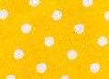 Yellow fabric texture with white polka dots Royalty Free Stock Photo
