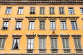 Yellow facade of old apartment house in Florence Royalty Free Stock Photo