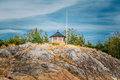 Yellow finnish lookout wooden house on island in rock summer Royalty Free Stock Photos