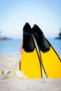 Yellow fins and snorkelling mask on beach in summer Royalty Free Stock Photo