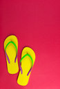 Yellow flip flop on red background pair of Stock Image
