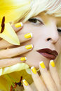 Yellow French manicure.