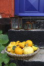 Yellow fruits in a basket on the stairs Stock Photos