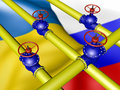 Yellow gas pipe and valve on a background of the flag of ukraine and russia Royalty Free Stock Photo