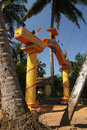 Yellow gate hinduism temple in goa palm trees and india Stock Photography