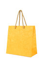 Yellow gift bag isolated on white. Royalty Free Stock Photo