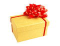 Yellow gift box with red ribbon and bow Stock Photography