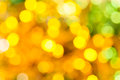 Yellow green blurred shimmering Christmas lights Royalty Free Stock Photo