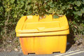 Yellow grit box besides road on steep hill Royalty Free Stock Image