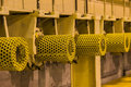 Yellow guard of steel roller shaft for safety in factory Royalty Free Stock Photo