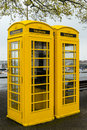 Yellow guernsey phone boxes telephone in channel islands are unlike the rest of the united kingdom Stock Photography