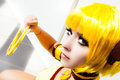 Yellow hair. Cosplay girl, costume cartoon Japanese manga.