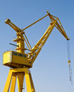 Yellow harbour crane on a sunny day Royalty Free Stock Photos